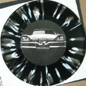 The Tommy Knockers - Noisy Beast - Seven inch black and white colored splattered vinyl on Dionysus Records